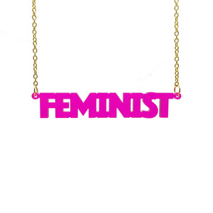 transparent hot pink all caps feminist necklace hanging