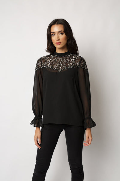 sheer black georgette top features frill cuff sleeves