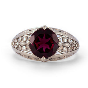 solid white gold vintage engagement ring with diamonds and garnet