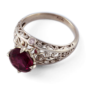 white gold vintage engagement ring with diamonds and garnet