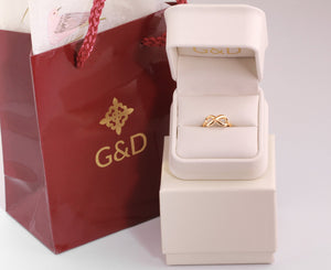 gold infinity ring in packaging of G&D Unique designs