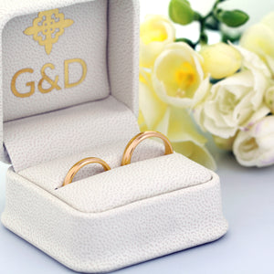 18K yellow gold wedding rings in a box