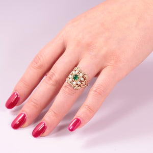 statement emerald ring with diamonds in solid yellow gold