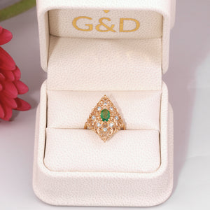 Emerald ring with diamonds in a gift box