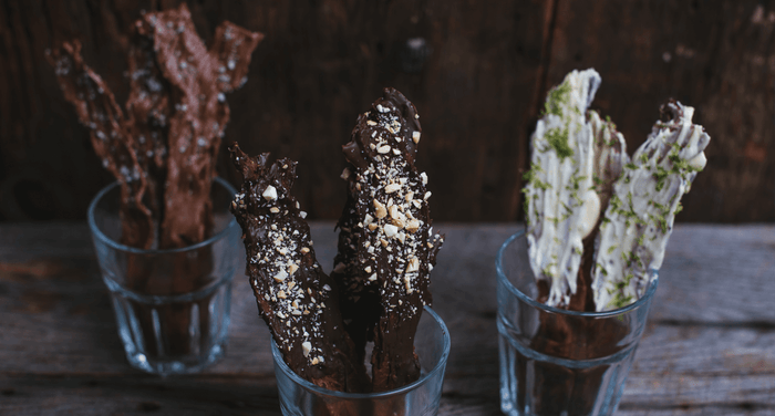 chocolate covered bacon bouquets in glasses