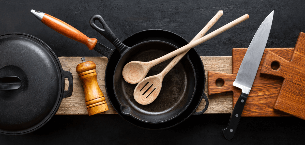 kitchen utensils on wooden plate