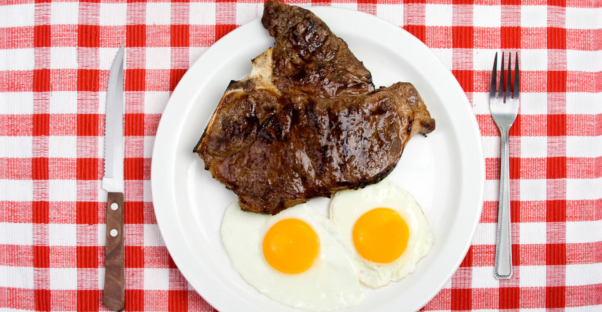 steak and eggs in plate