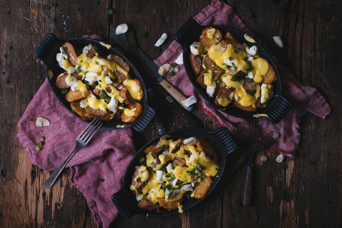 breakfast poutine with sausages, potatoes and cheese