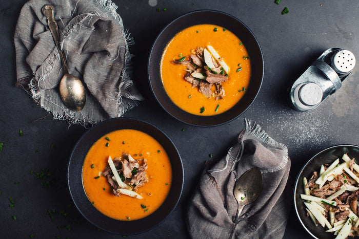 Carrot and Ginger Soup with Duck Topping