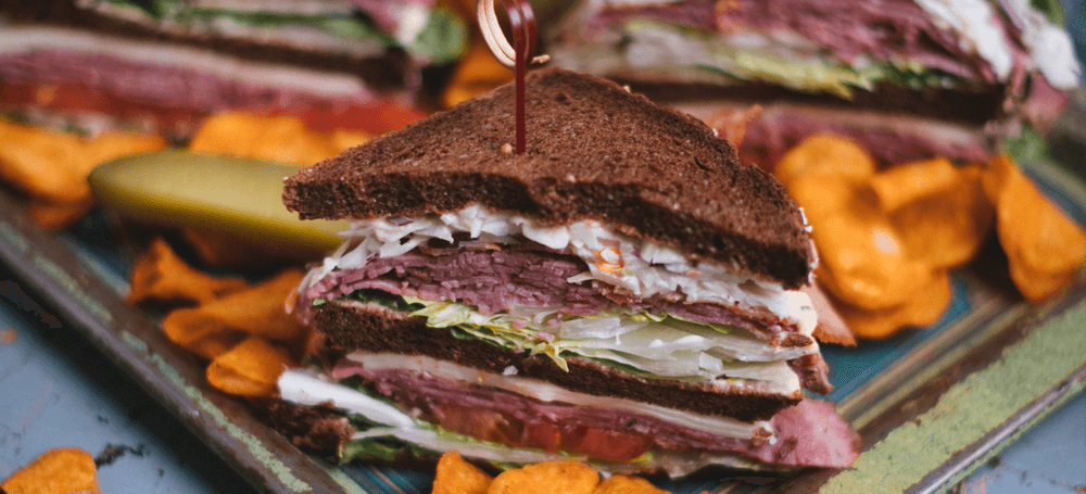 club sandwich in pumpernickel brown bread and smoked meat