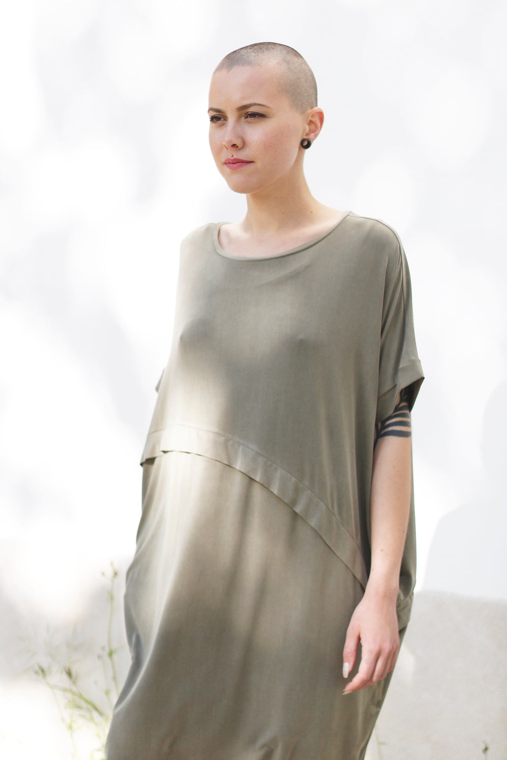 Dress With An Asymmetric Band in Green.