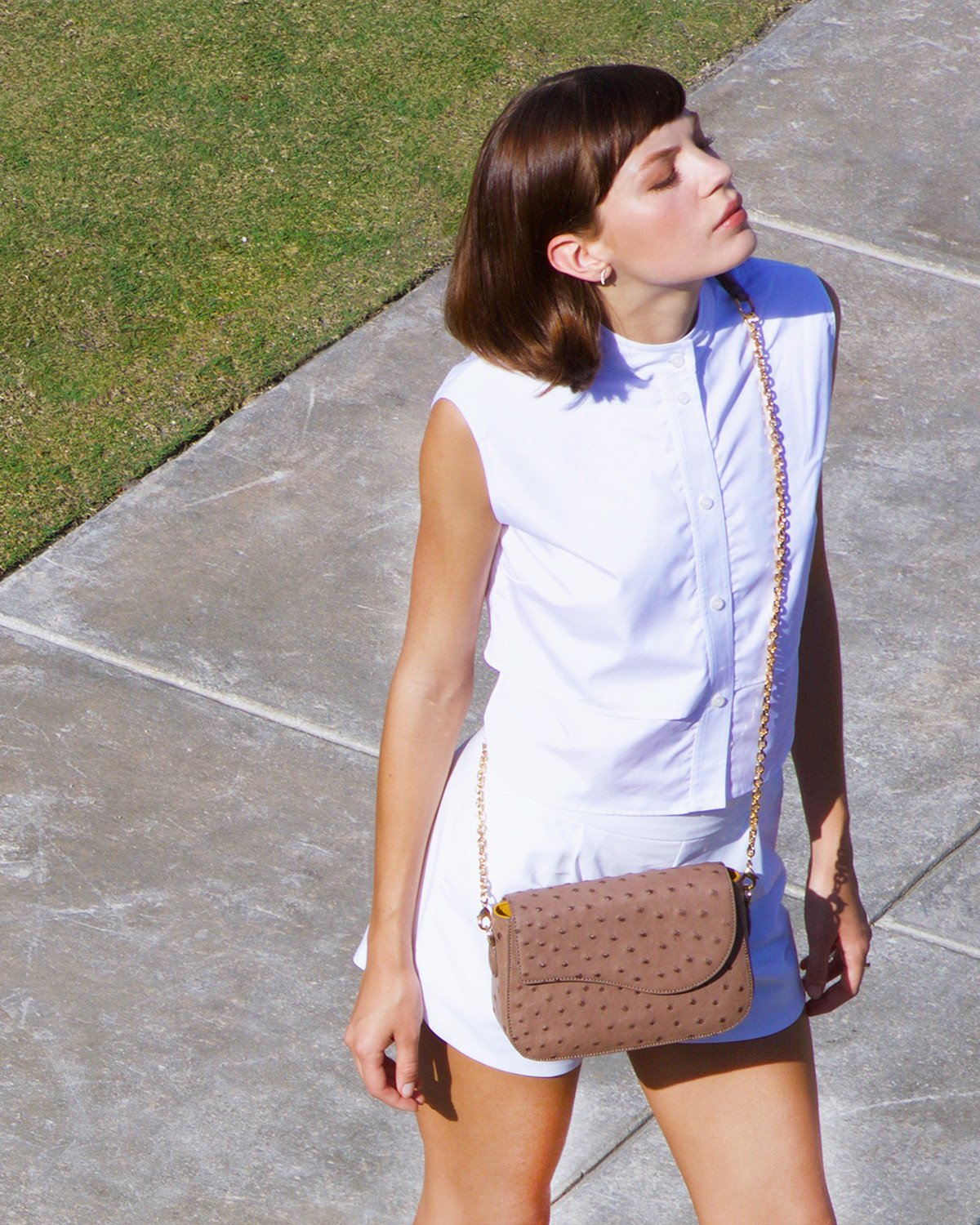 Model wearing Crossbody The YB Edgar Ostrich Bag in Light Brown Ostrich Miami