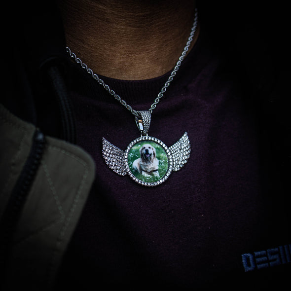 THE HIGH FLYER // WINGS PHOTO PENDANT is an essential piece to add to your collection to remember an OG in your life...5x Plated with Solid 18k Gold x Diamonds, this custom photo pendant has a breathtaking luster for a price that you simply can't find anywhere else. Stop Settling and Shop OG.