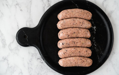 Pork sausage with Black Pudding and Roasted Onion.