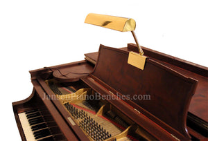 brass piano lamp with steinway piano