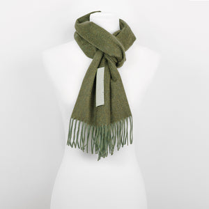 The Biellese Cashmere scarf with Calfskin leather. 100% Cashmere & R. Horn´s Calfskin Leather 30 x 180 cm. Made in collaboration with R. Horn Vienna. Pictured: Forest Green Cashmere with the mint green leather label