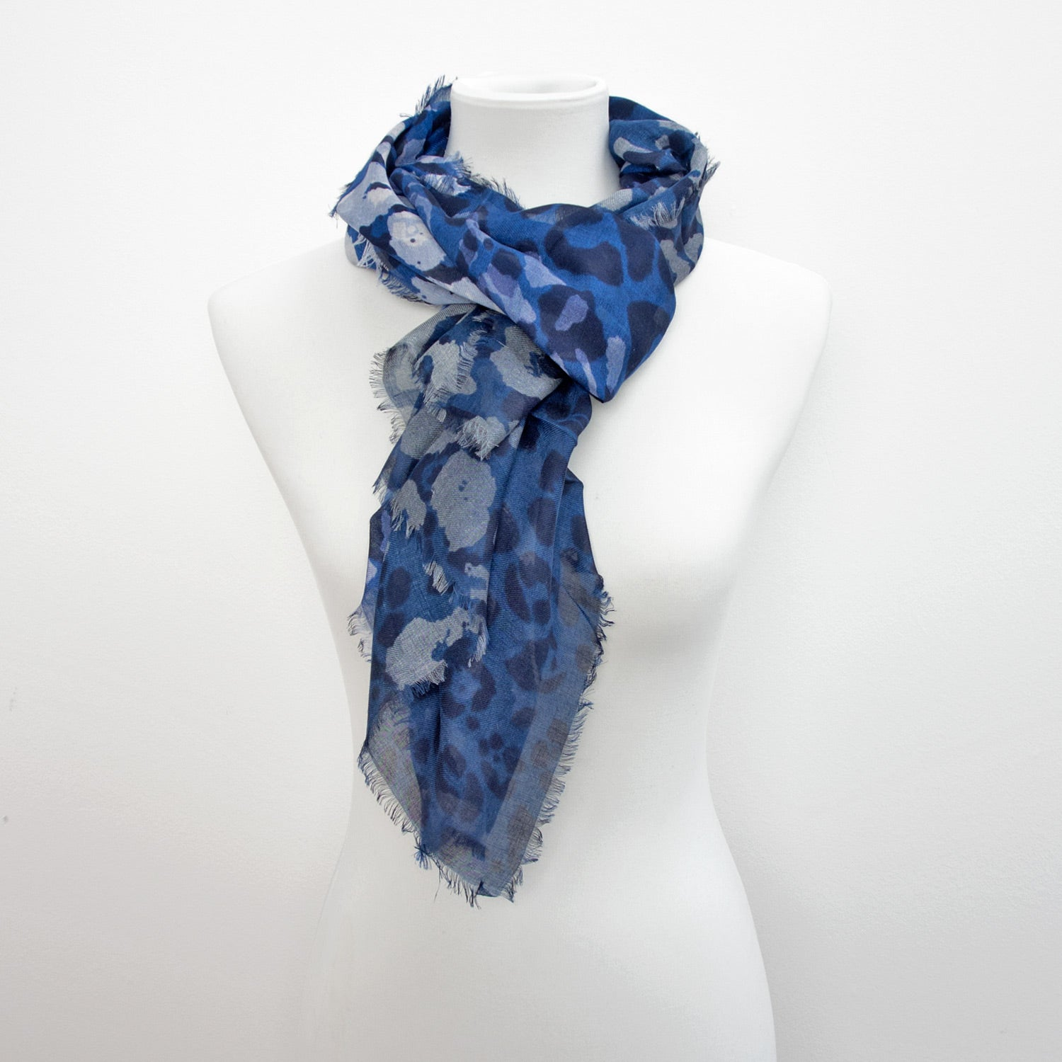 Doria & Dojola Camouflage Cashmere-Modal Scarf. 85% Modal 15% Cashmere  67 x 176 cm. 100% Made in Italy. Pictured in Blue.