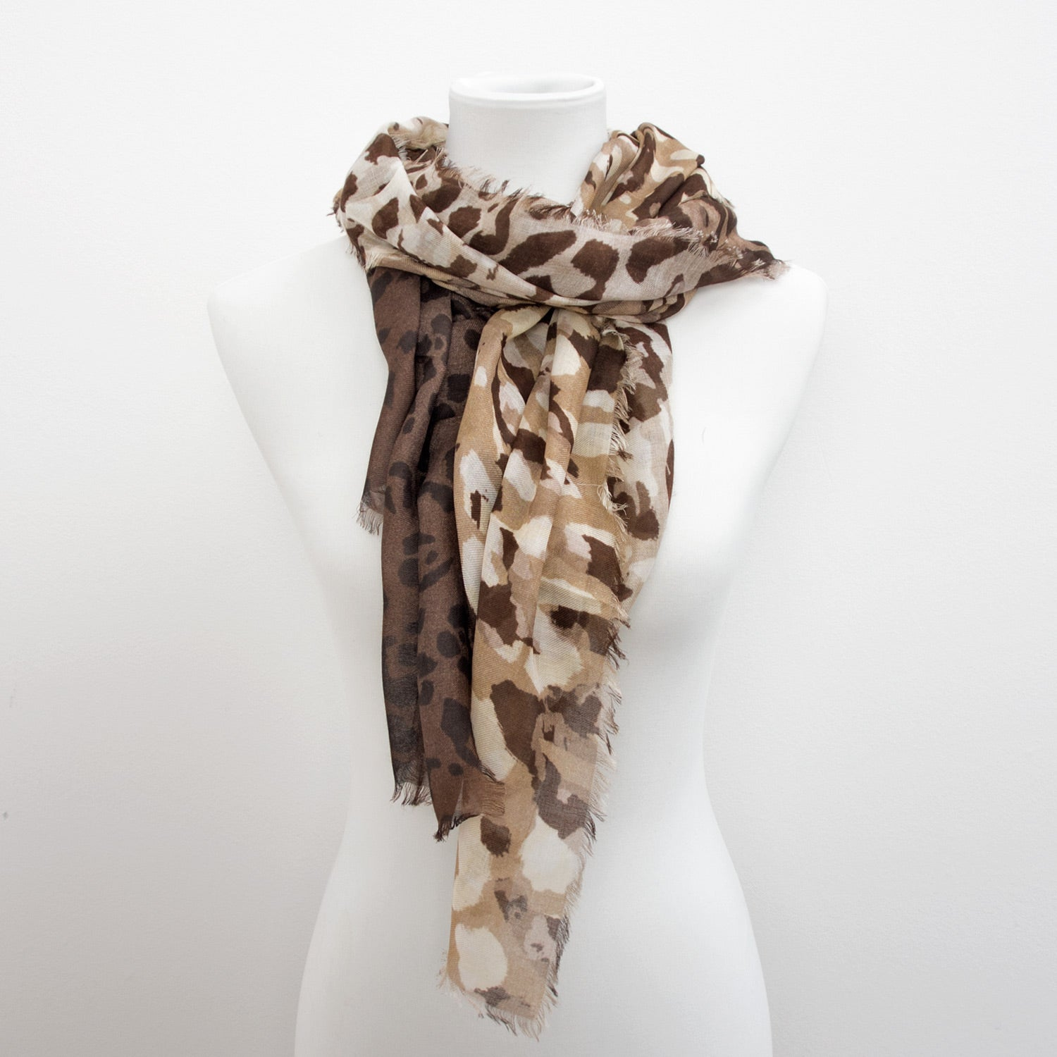 Doria & Dojola Camouflage Cashmere-Modal Scarf. 85% Modal 15% Cashmere  67 x 176 cm. 100% Made in Italy. Pictured in Beige.