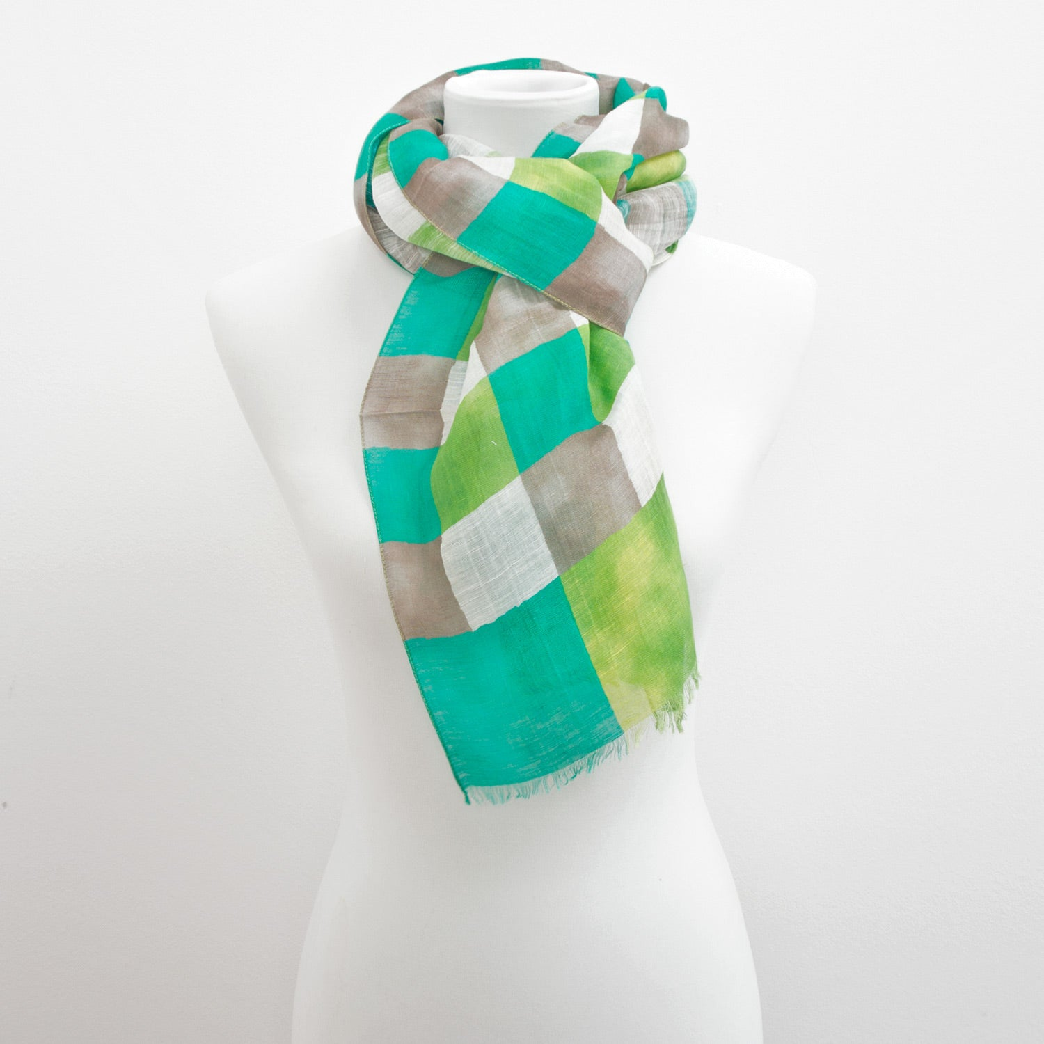 Doria & Dojola Checkered Linen-Blend Scarf. 73% Linen 23% Modal 4% Silk 43 x 170 cm. 100% Made in Italy.
