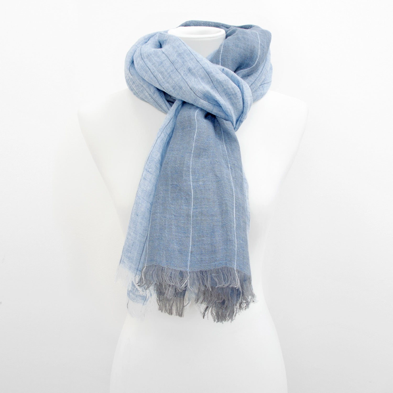 Doria & Dojola Pin Stripes Linen Shawl. 100% Linen 75 cm x 200 cm. Made in Italy. Pictured in Light Blue.