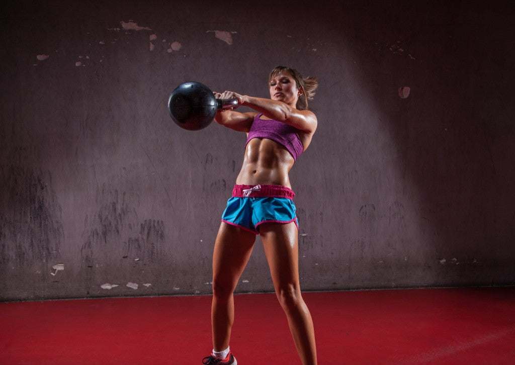 woman doing kettlebell workout