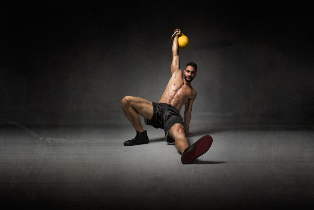 man performs turkish get up kettlebell exercise
