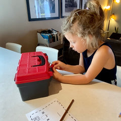 girl playing Blimey Box escape game