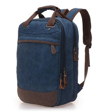 "Load image into Gallery viewer, A dark blue casual canvas backpack perfect for overnight trips that fits laptops up to 15.5"" screens,  Perfect for airline carry on luggage."