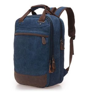 "A dark blue casual canvas backpack perfect for overnight trips that fits laptops up to 15.5"" screens,  Perfect for airline carry on luggage."