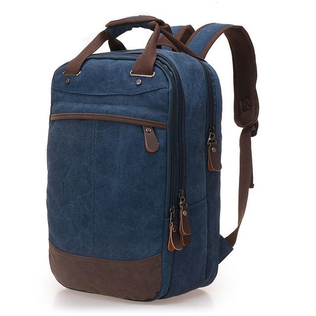 A dark blue casual canvas backpack perfect for overnight trips that fits laptops up to 15.5
