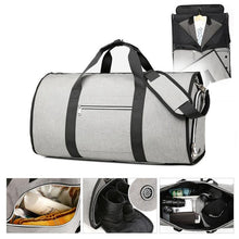 Load image into Gallery viewer, A very clever large capacity garment travel bag and suit carrier that unfolds and allows you to pack your suit around your clothes and items. The bag unzips to allow you to lay it out flat. Once flat insert the suit in its concealed compartment and roll it round your clothes and shoes.