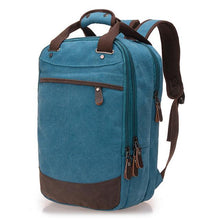 "Load image into Gallery viewer, A light blue casual canvas backpack perfect for overnight trips that fits laptops up to 15.5"" screens,  Perfect for airline carry on luggage."