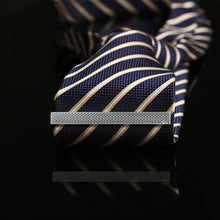 Load image into Gallery viewer, An example of how the silver ridgeback tie clip will look like on a tie