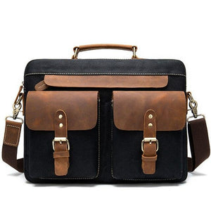 "A briefcase style messenger bag with a sturdy handle and detachable, adjustable shoulder strap.  Two press stud sealed pockets on the front exterior and a zipper pocket on the back gives further storage options.  Internal storage includes a dedicated pocket for a 14"" laptop, a main compartment and a separate zip pocket"