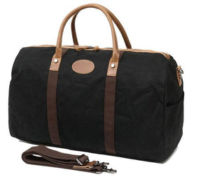 This fantastic large capacity black waxed canvas duffel bag is perfect for weekend trips.  The interior has loads of space, a zip pocket and two pouches to keep your belongings organised.