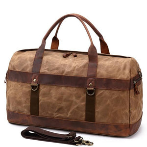 This brown vintage wax canvas weekend duffel bag is ideal for shorter holidays.   On the inside there's loads of room to keep clothes and a laptop with plenty of space to spare for other items . There are also two smaller pockets at each end for smaller items.  The bottom is protected with five brass studs and it comes with a detachable shoulder strap for convenience.