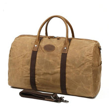 Load image into Gallery viewer, This fantastic large capacity brown waxed canvas duffel bag is perfect for weekend trips.  The interior has loads of space, a zip pocket and two pouches to keep your belongings organised.
