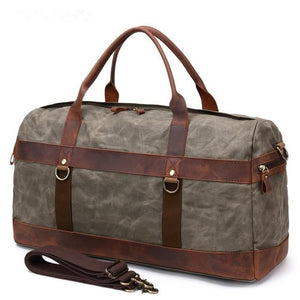This green vintage wax canvas weekend duffel bag is ideal for shorter holidays.   On the inside there's loads of room to keep clothes and a laptop with plenty of space to spare for other items . There are also two smaller pockets at each end for smaller items.  The bottom is protected with five brass studs and it comes with a detachable shoulder strap for convenience.