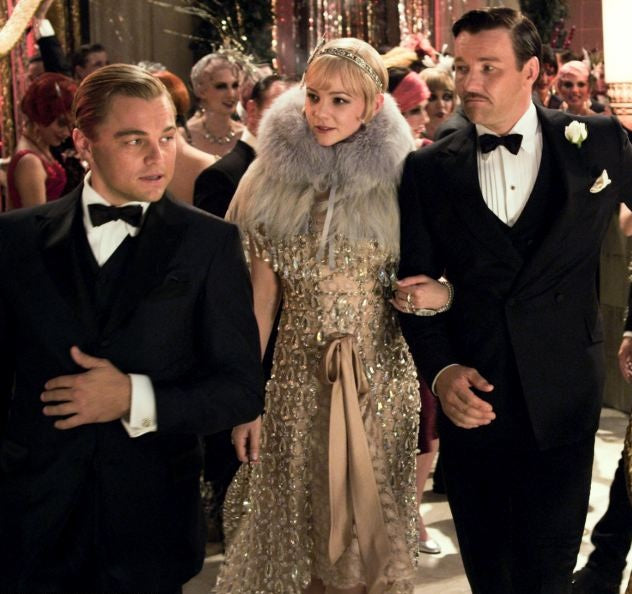 Jay Gatsby wearing suit in party scene taken from The Great Gatsby Film