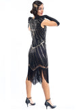 A black flapper dress with gold sequins and beads