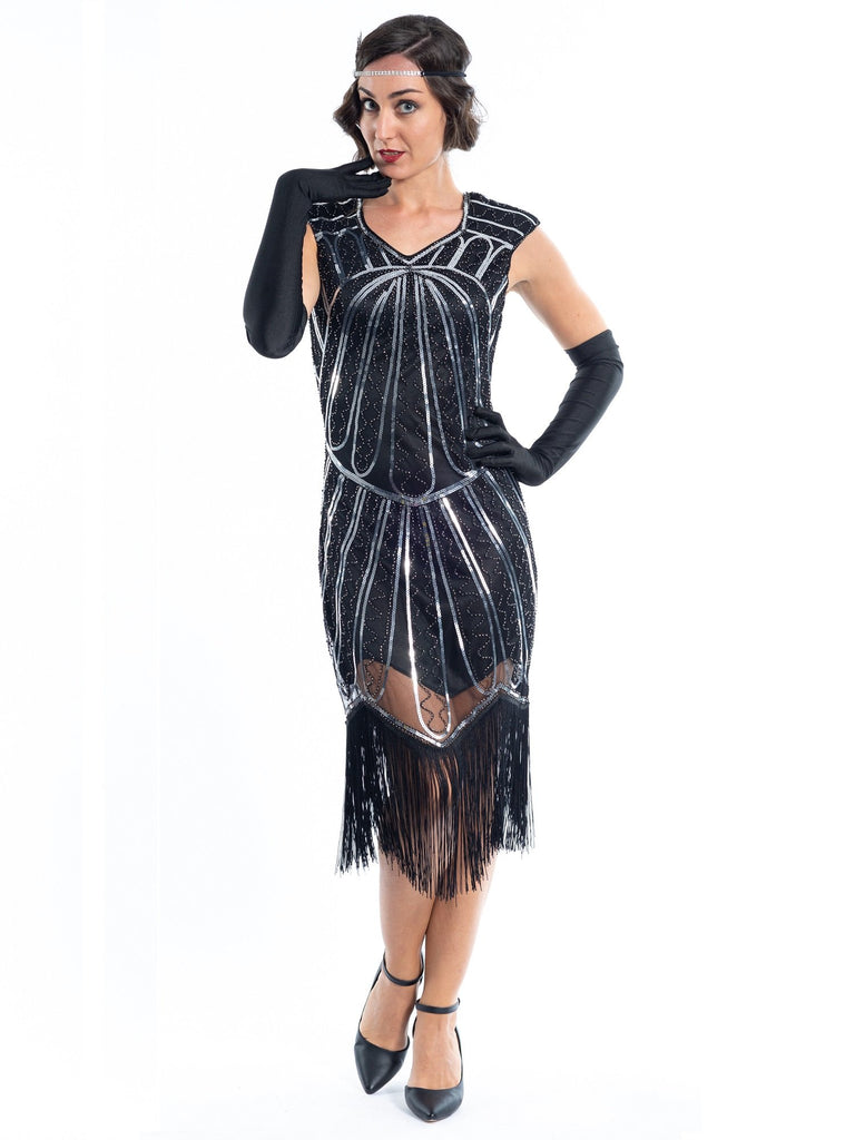 A black flapper dress with silver sequins and beads
