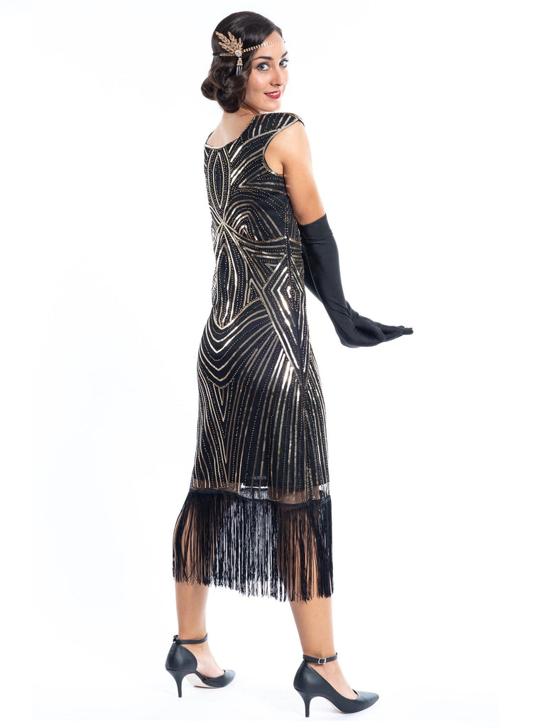 A Vintage Black Flapper Dress with Gold Sequins and Beads