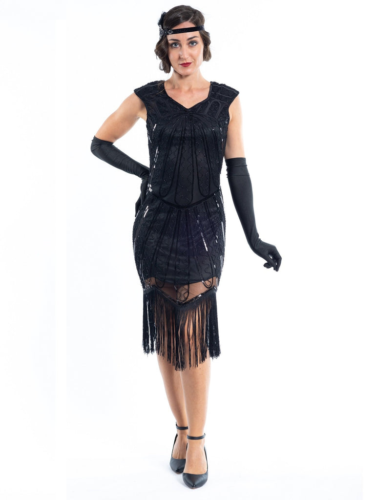 A black flapper dress with a pattern of beads and sequins