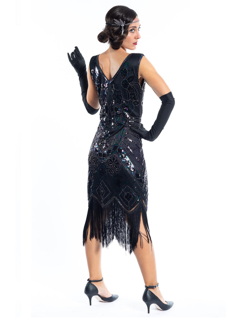 A vintage 1920s black great gatsby dress with sequins and beads