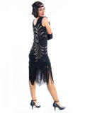A black vintage flapper dress with black and gold sequins, gold beads and fringes around the hem - back view