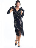 A black vintage flapper dress with black and gold sequins, gold beads and fringes around the hem