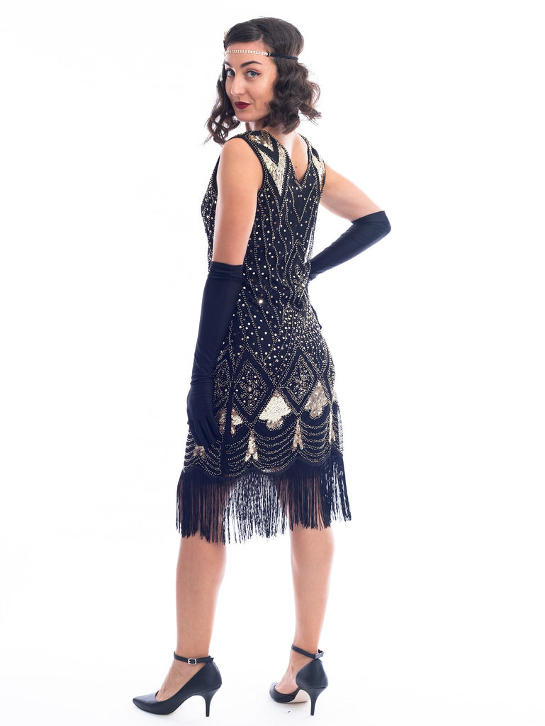 A black and gold sleeveless 1920's Flapper Dress with sequins and beads