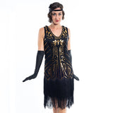 A black flapper dress with gold sequins, beads and black fringes around the hem - Close View