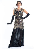 A long black flapper dress gold sequins and beads