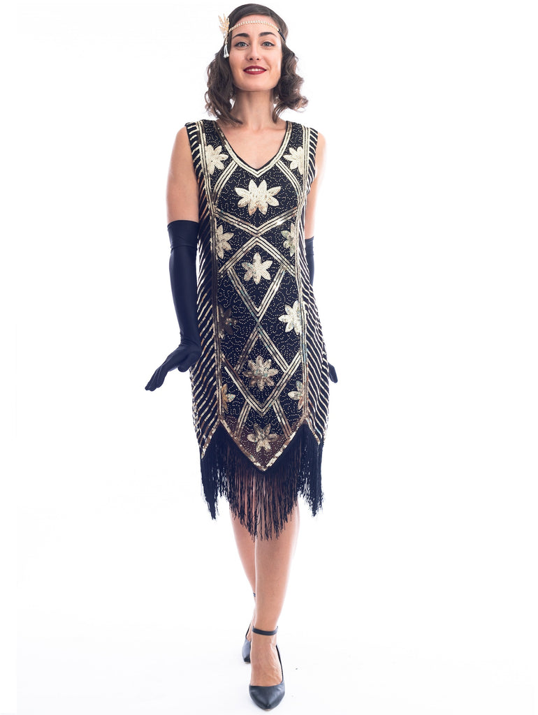A 1920s black and gold flapper dress with sequins and floral pattern